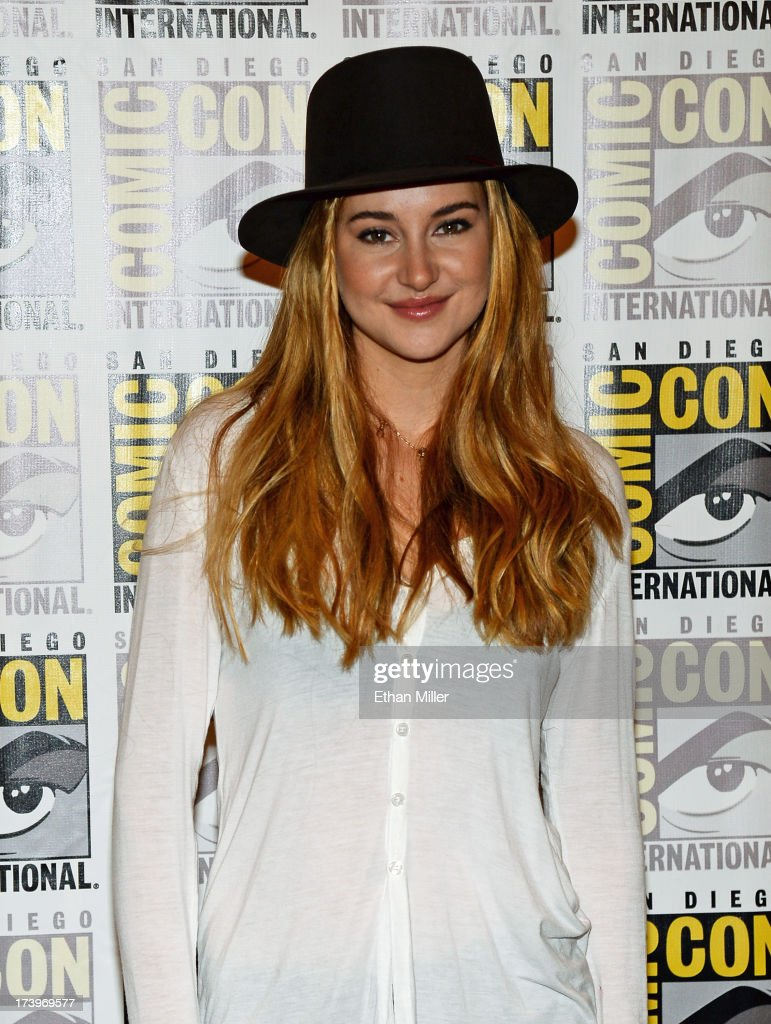 Actress <a gi-track='captionPersonalityLinkClicked' href=/galleries/search?phrase=Shailene+Woodley&family=editorial&specificpeople=676833 ng-click='$event.stopPropagation()'>Shailene Woodley</a> attends the 'Ender's Game' and 'Divergent' press line during Comic-Con International 2013 at the Hilton San Diego Bayfront Hotel on July 18, 2013 in San Diego, California.