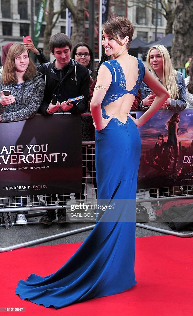 US actress Shailene Woodley poses for pictures on the red carpet upon arrival to attend the European premiere of the latest film 'Divergent' in...