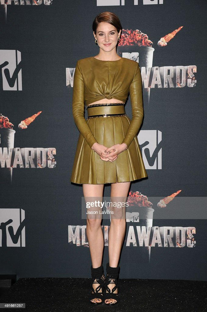 Actress Shailene Woodley poses in the press room at the 2014 MTV Movie Awards at Nokia Theatre L.A. Live on April 13, 2014 in Los Angeles, California.