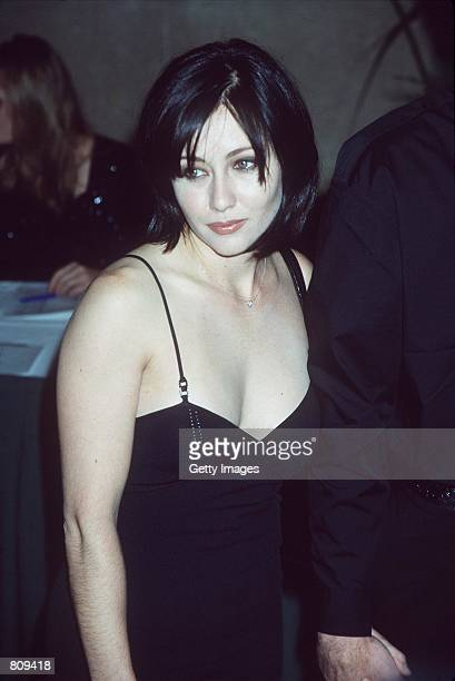 Actress Shannen Doherty attends the Spelling Entertainment Holiday Bash at the International Ballroom December 4 1998 in Beverly Hills CA The former...