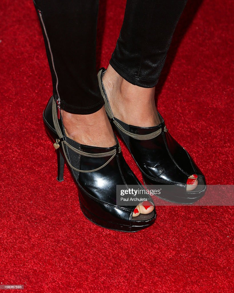Actress Shannon Bobo (shoe D=detail) attends the 'Under The Mistletoe' charity event benefiting the Toys For Tots Foundation at the Lexington Social House on December 14, 2012 in Hollywood, California.