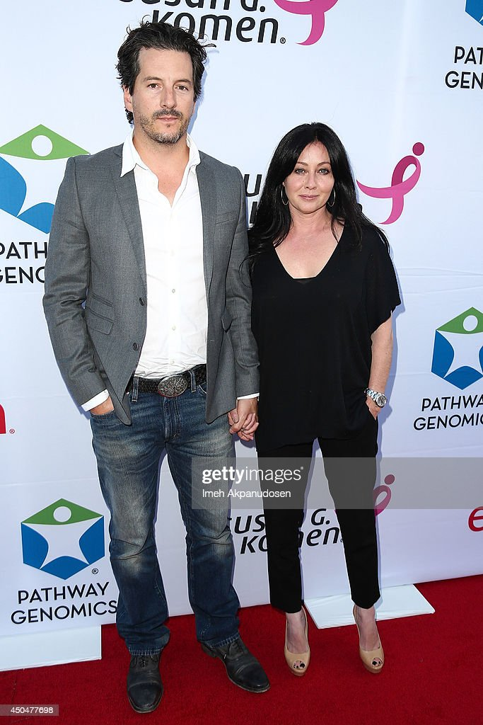 Actress Shannon Doherty (R) and husband, <a gi-track='captionPersonalityLinkClicked' href=/galleries/search?phrase=Kurt+Iswarienko&family=editorial&specificpeople=5825607 ng-click='$event.stopPropagation()'>Kurt Iswarienko</a>, attend the Pathway To The Cures For Breast Cancer fundraiser benefiting Susan G. Komen presented by Relativity Media and Pathway Genomics at Santa Monica Airport on June 11, 2014 in Santa Monica, California.