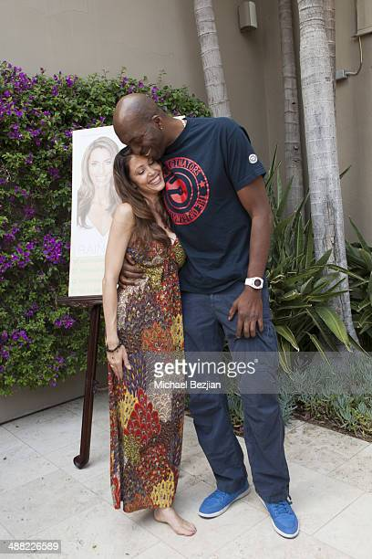 Actress Shannon Elizabeth and NBA Champion John Salley pose for a picture at Rainbeau Mars' 21 Day Superstar Cleanse Book Launch on May 4 2014 in...