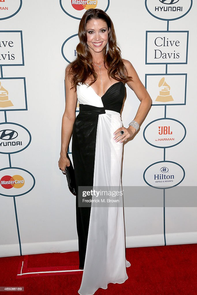 Actress <a gi-track='captionPersonalityLinkClicked' href=/galleries/search?phrase=Shannon+Elizabeth&family=editorial&specificpeople=201622 ng-click='$event.stopPropagation()'>Shannon Elizabeth</a> attends the 56th annual GRAMMY Awards Pre-GRAMMY Gala and Salute to Industry Icons honoring Lucian Grainge at The Beverly Hilton on January 25, 2014 in Beverly Hills, California.