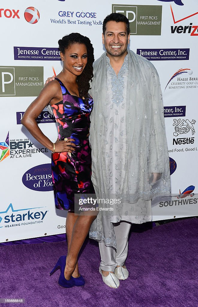 Actress Shanola Hampton (L) and Executive Producer Riaz Patel arrive at the Jenesse Center's 2013 Silver Rose Gala & Auction at Vibiana on April 6, 2013 in Los Angeles, California.