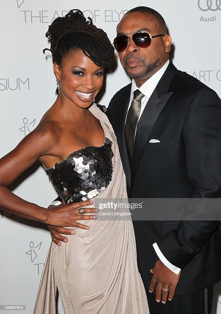 Actress Shanola Hampton (L) and husband John Shango attend the Art of Elysium's 6th Annual Black-tie Gala 'Heaven' at 2nd Street Tunnel on January 12, 2013 in Los Angeles, California.
