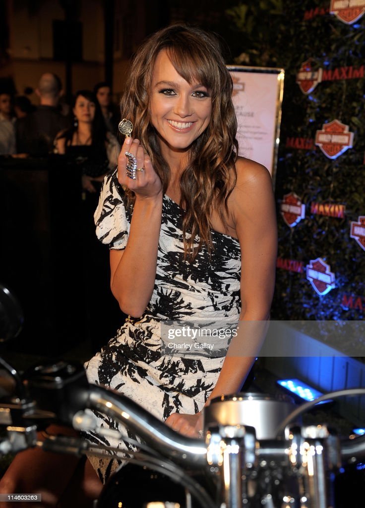 Actress Sharni Vinson turns the key on a Harley-Davidson to raise money for Harley's Heroes at the 2010 Maxim Hot 100 Party held at Paramount Studios on May 19, 2010 in Los Angeles, California.