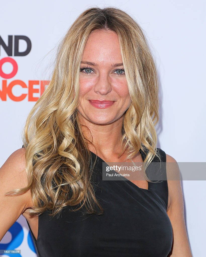 Actress <a gi-track='captionPersonalityLinkClicked' href=/galleries/search?phrase=Sharon+Case&family=editorial&specificpeople=215357 ng-click='$event.stopPropagation()'>Sharon Case</a> attends the CBS After Dark with an evening of laughter benefiting Stand Up To Cancer at The Comedy Store on October 8, 2013 in West Hollywood, California.