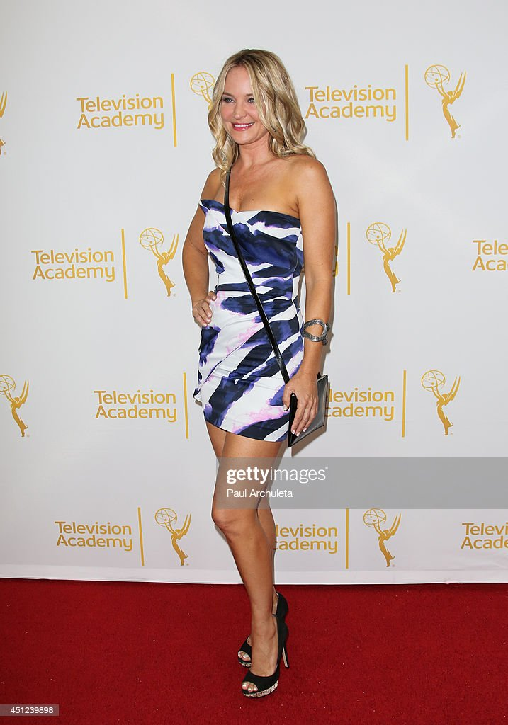 Actress <a gi-track='captionPersonalityLinkClicked' href=/galleries/search?phrase=Sharon+Case&family=editorial&specificpeople=215357 ng-click='$event.stopPropagation()'>Sharon Case</a> attends the Daytime Emmy Nominee Reception at The London West Hollywood on June 19, 2014 in West Hollywood, California.
