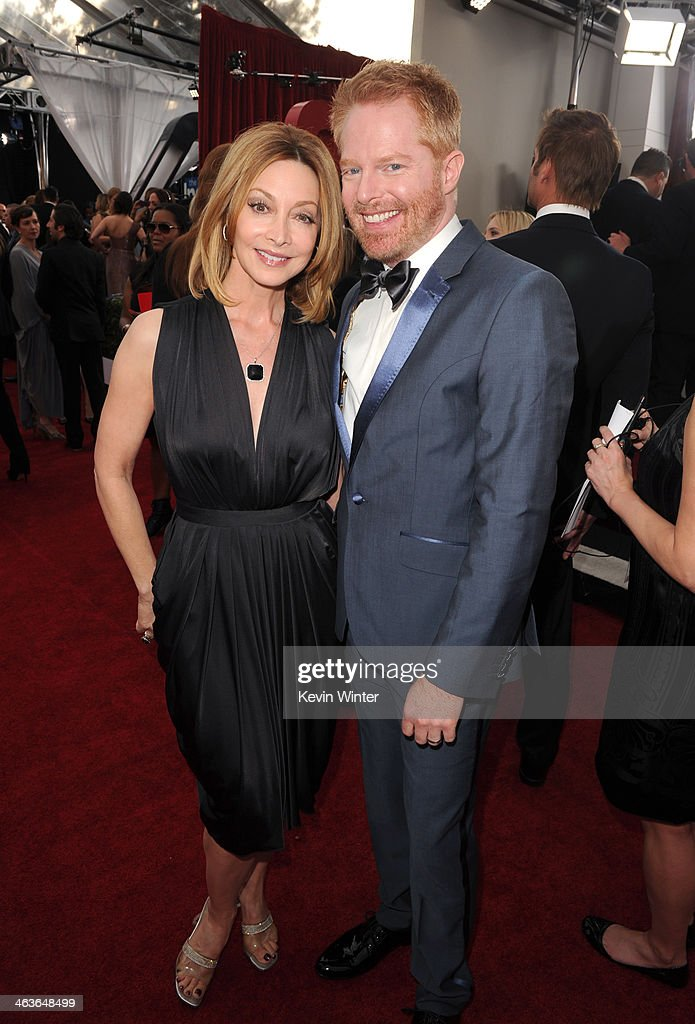 Actress <a gi-track='captionPersonalityLinkClicked' href=/galleries/search?phrase=Sharon+Lawrence&family=editorial&specificpeople=202246 ng-click='$event.stopPropagation()'>Sharon Lawrence</a> (L) and actor <a gi-track='captionPersonalityLinkClicked' href=/galleries/search?phrase=Jesse+Tyler+Ferguson&family=editorial&specificpeople=633114 ng-click='$event.stopPropagation()'>Jesse Tyler Ferguson</a> attend the 20th Annual Screen Actors Guild Awards at The Shrine Auditorium on January 18, 2014 in Los Angeles, California.