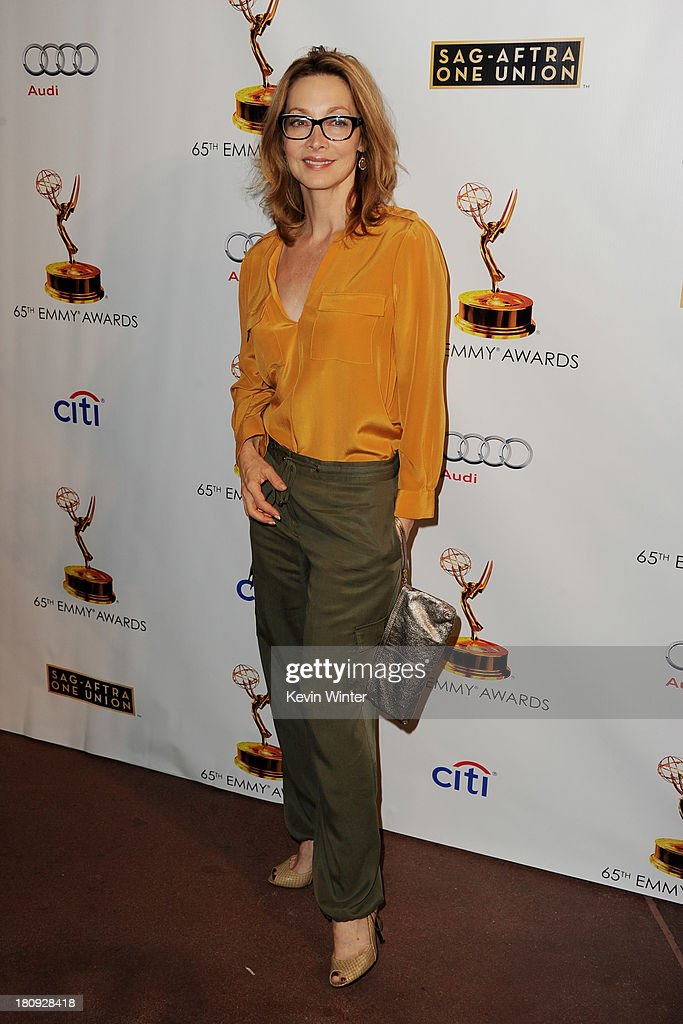 Actress Sharon Lawrence arrives at The Academy of Television Arts & Sciences and SAG-AFTRA celebration of the 65th Primetime Emmy Award nominees at the Television Academy on September 17, 2013 in No. Hollywood, California.