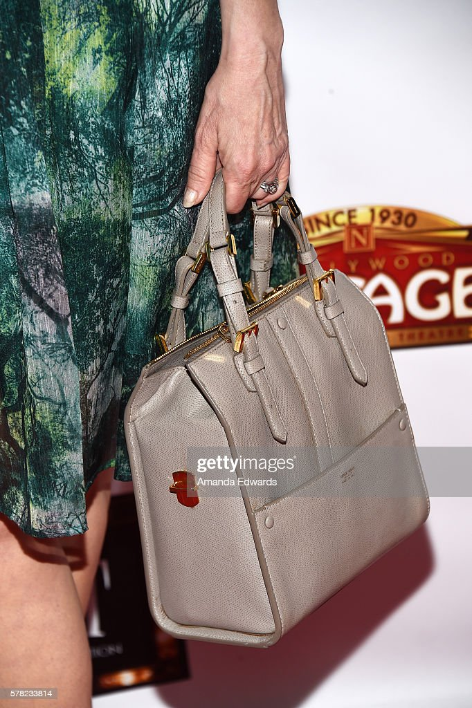 Actress Sharon Lawrence, handbag detail, arrives at the opening of 'Cabaret' at the Hollywood Pantages Theatre on July 20, 2016 in Hollywood, California.