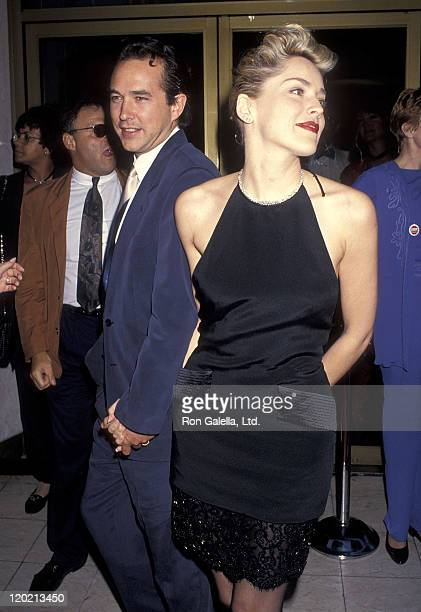 Actress Sharon Stone and boyfriend Bill MacDonald attend the 'Sliver' Westwood Premiere on May 19 1993 at Mann National Theatre in Westwood California