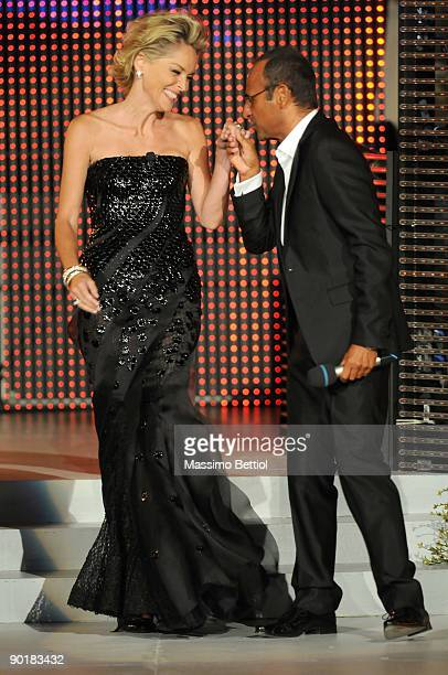 Actress Sharon Stone and Carlo Conti attend the 2009 Rudolph Valentino International Cinema Awards at the Poltu Quatu Harbour Resort on August 29...