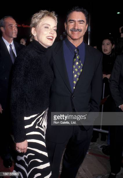 Actress Sharon Stone and fiance Phil Bronstein attend the 'Sphere' Westwood Premiere on February 11 1998 at Mann Village Theatre in Westwood...