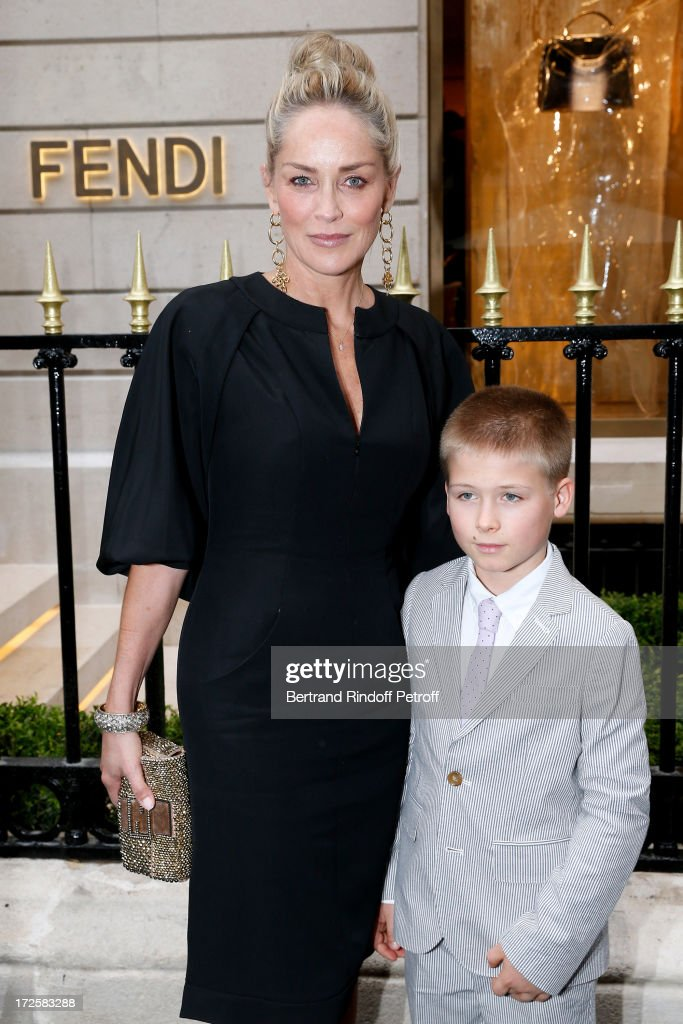 Actress <a gi-track='captionPersonalityLinkClicked' href=/galleries/search?phrase=Sharon+Stone&family=editorial&specificpeople=156409 ng-click='$event.stopPropagation()'>Sharon Stone</a> and her son <a gi-track='captionPersonalityLinkClicked' href=/galleries/search?phrase=Roan+Bronstein&family=editorial&specificpeople=233461 ng-click='$event.stopPropagation()'>Roan Bronstein</a> attend the Avenue Montaigne Fendi new shop opening party, which will be followeed by 'The Glory Of Water' : Karl Lagerfeld's Exhibition Preview - on July 3, 2013 in Paris, France.
