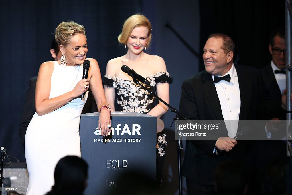 Actress Sharon Stone and Nicole Kidman speak on stage as part of amfAR's 20th Annual Cinema Against AIDS during The 66th Annual Cannes Film Festival at Hotel du Cap-Eden-Roc on May 23, 2013 in Cap d'Antibes, France.