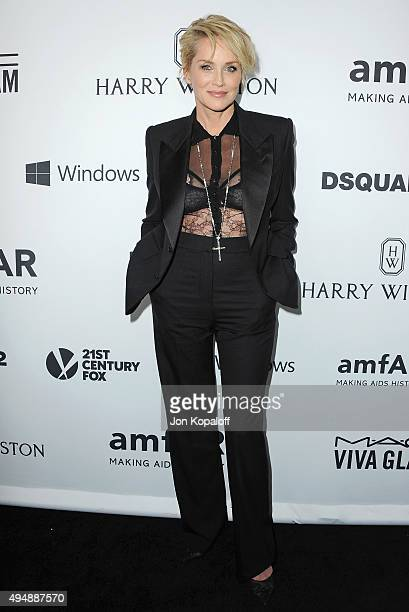 Actress Sharon Stone arrives at amfAR's Inspiration Gala Los Angeles at Milk Studios on October 29 2015 in Hollywood California