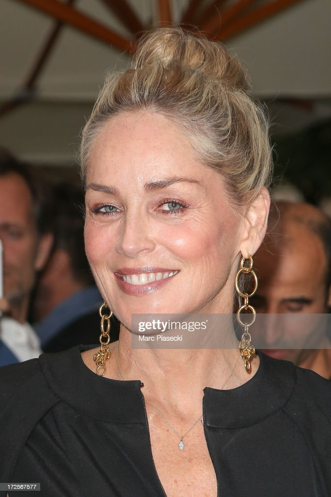Actress <a gi-track='captionPersonalityLinkClicked' href=/galleries/search?phrase=Sharon+Stone&family=editorial&specificpeople=156409 ng-click='$event.stopPropagation()'>Sharon Stone</a> arrives to attend the 'The Glory of Water' Karl Lagerfeld's exhibition at FENDI store on Avenue Montaigne on July 3, 2013 in Paris, France.