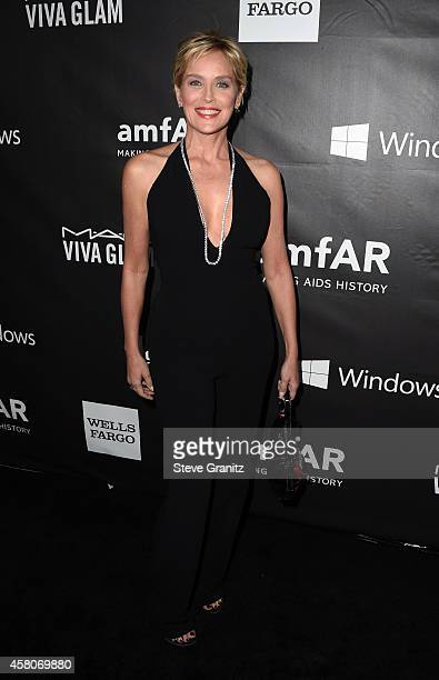Actress Sharon Stone attends amfAR LA Inspiration Gala honoring Tom Ford at Milk Studios on October 29 2014 in Hollywood California