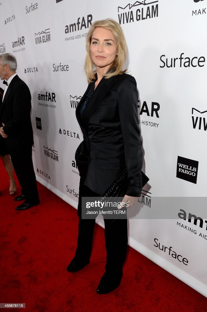 Actress <a gi-track='captionPersonalityLinkClicked' href=/galleries/search?phrase=Sharon+Stone&family=editorial&specificpeople=156409 ng-click='$event.stopPropagation()'>Sharon Stone</a> attends the 2013 amfAR Inspiration Gala Los Angeles at Milk Studios on December 12, 2013 in Los Angeles, California.