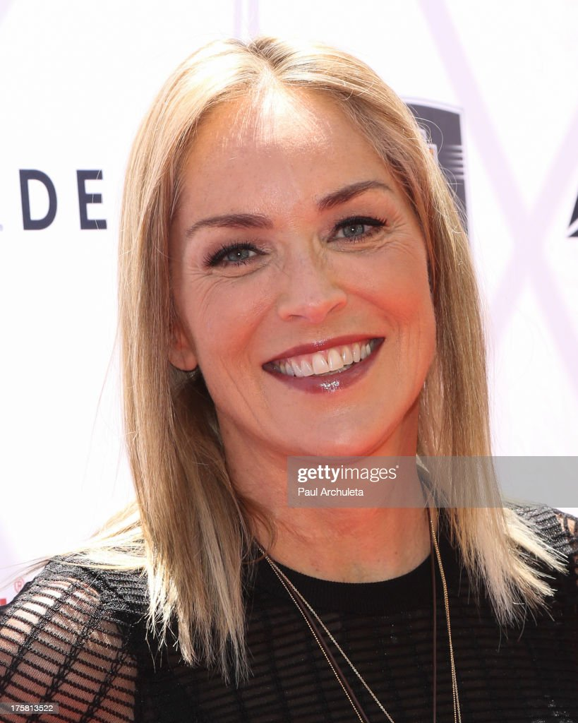 Actress <a gi-track='captionPersonalityLinkClicked' href=/galleries/search?phrase=Sharon+Stone&family=editorial&specificpeople=156409 ng-click='$event.stopPropagation()'>Sharon Stone</a> attends the 4th annual Kiehl's LifeRide for amfAR at The Grove on August 8, 2013 in Los Angeles, California.