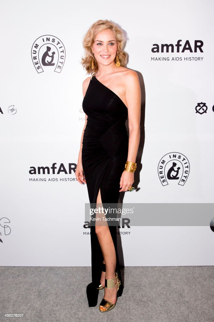 Actress <a gi-track='captionPersonalityLinkClicked' href=/galleries/search?phrase=Sharon+Stone&family=editorial&specificpeople=156409 ng-click='$event.stopPropagation()'>Sharon Stone</a> attends the inaugural amfAR India event at the Taj Mahal Palace Mumbai on November 17, 2013 in Mumbai, India.