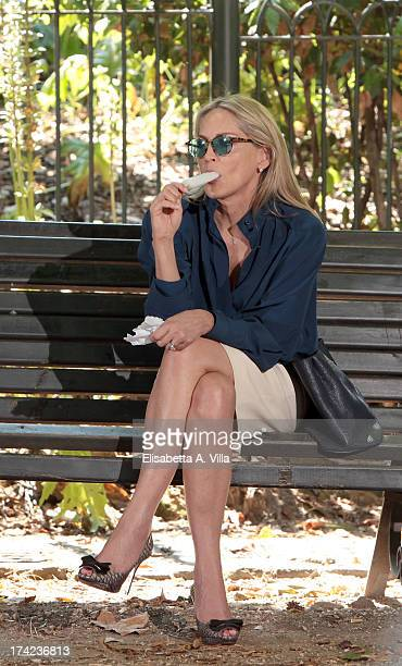 Actress Sharon Stone enjoys an ice lolly during a pause while shooting on location for Italian movie 'Un Ragazzo D'Oro' directed by Pupi Avati at...