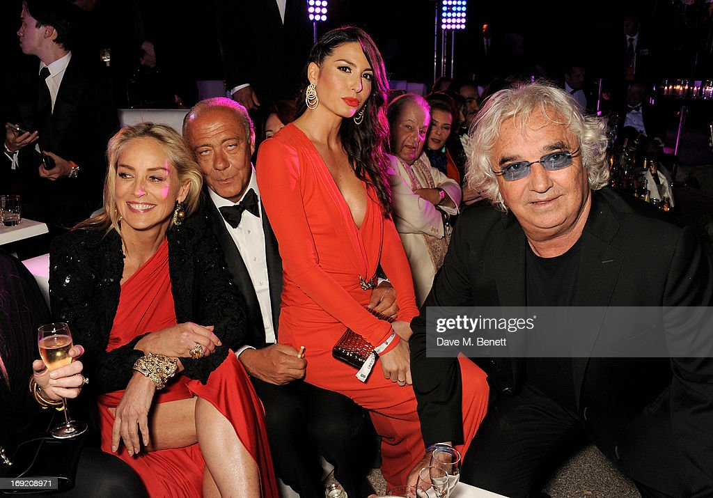 Actress <a gi-track='captionPersonalityLinkClicked' href=/galleries/search?phrase=Sharon+Stone&family=editorial&specificpeople=156409 ng-click='$event.stopPropagation()'>Sharon Stone</a>, Founder and President of de Grisogono <a gi-track='captionPersonalityLinkClicked' href=/galleries/search?phrase=Fawaz+Gruosi&family=editorial&specificpeople=206588 ng-click='$event.stopPropagation()'>Fawaz Gruosi</a>, <a gi-track='captionPersonalityLinkClicked' href=/galleries/search?phrase=Elisabetta+Gregoraci&family=editorial&specificpeople=606805 ng-click='$event.stopPropagation()'>Elisabetta Gregoraci</a> and <a gi-track='captionPersonalityLinkClicked' href=/galleries/search?phrase=Flavio+Briatore&family=editorial&specificpeople=220211 ng-click='$event.stopPropagation()'>Flavio Briatore</a> attends the de Grisogono Party during the 66th International Cannes Film Festival at Hotel Du Cap on May 21, 2013 in Antibes, France.