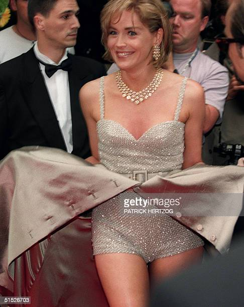 US actress Sharon Stone her skirt flying in the wind arrives 26 May 1995 in a Cannes movie theater for the screening of 'Unzipped' a movie directed...