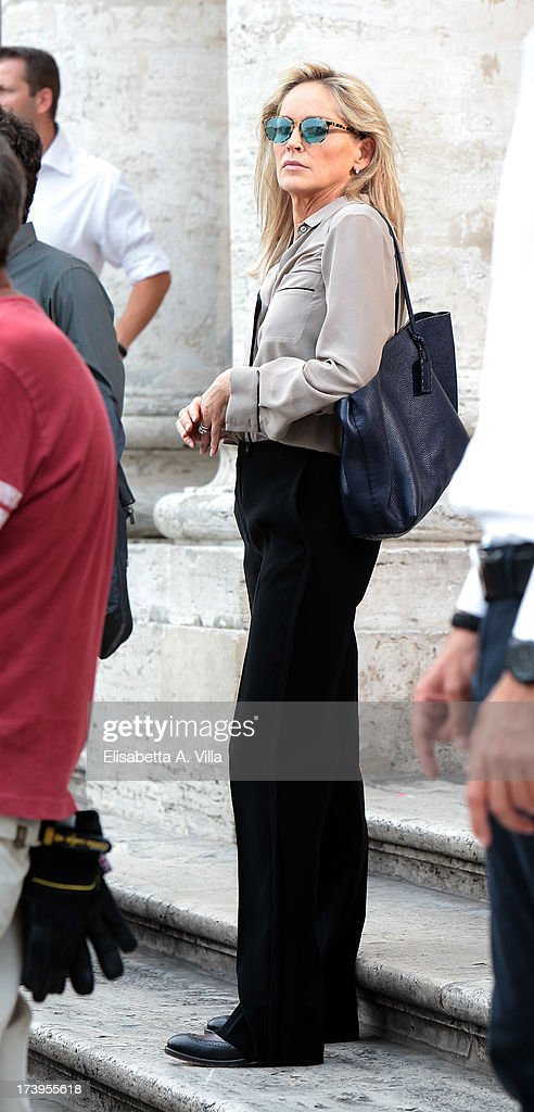 Actress <a gi-track='captionPersonalityLinkClicked' href=/galleries/search?phrase=Sharon+Stone&family=editorial&specificpeople=156409 ng-click='$event.stopPropagation()'>Sharon Stone</a> is seen on the set of the Italian movie 'Un Ragazzo D'Oro' directed by Pupi Avati at Piazza Del Popolo on July 18, 2013 in Rome, Italy.