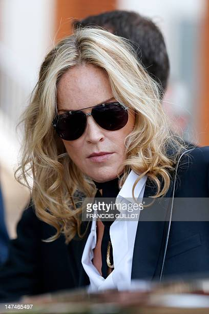US actress Sharon Stone leaves the men's springsummer 2013 fashion collection show of Belgian designer Kris Van Assche for the label Dior on June 30...