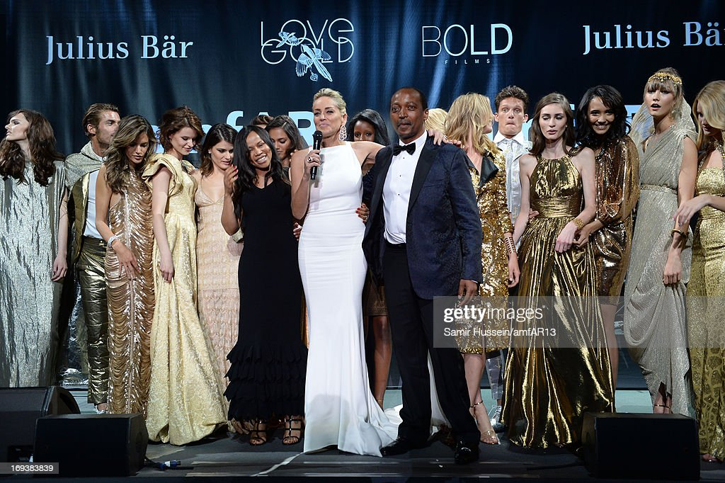 Actress Sharon Stone on stage with models at amfAR's 20th Annual Cinema Against AIDS during The 66th Annual Cannes Film Festival at Hotel du Cap-Eden-Roc on May 23, 2013 in Cap d'Antibes, France.