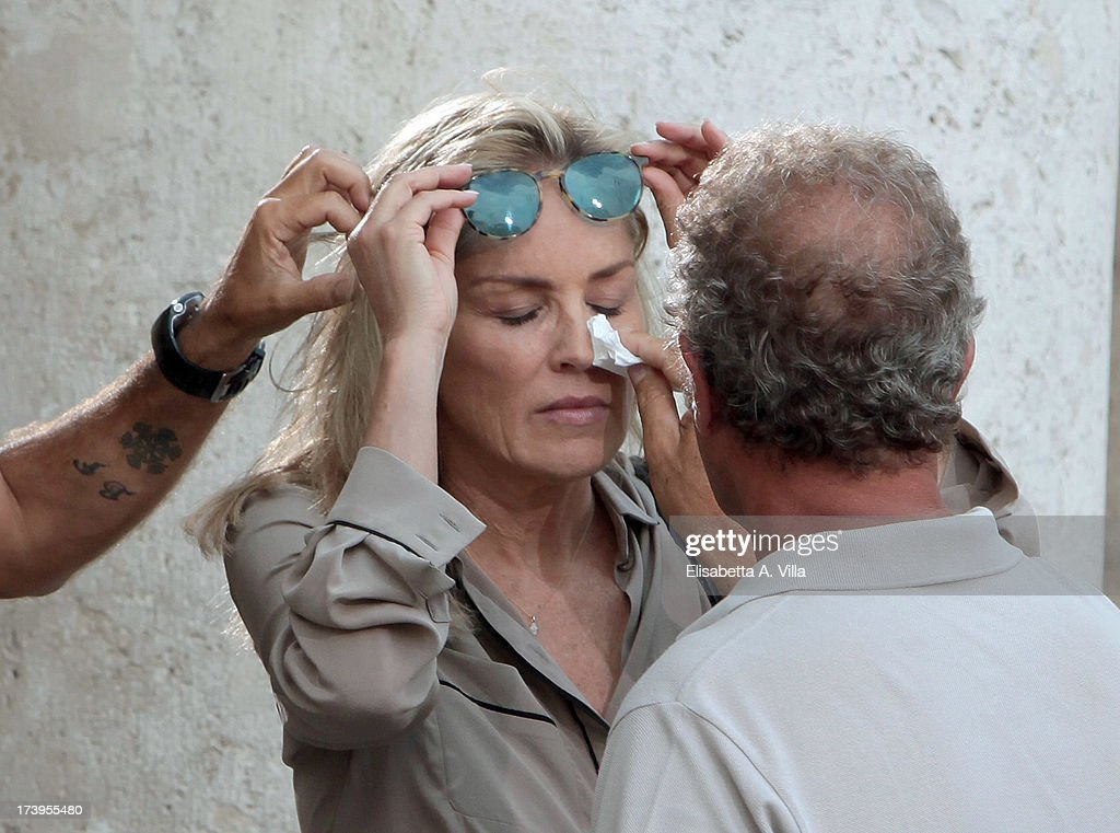 Actress <a gi-track='captionPersonalityLinkClicked' href=/galleries/search?phrase=Sharon+Stone&family=editorial&specificpeople=156409 ng-click='$event.stopPropagation()'>Sharon Stone</a> receives make up before filming the Italian movie 'Un Ragazzo D'Oro' (A golden boy) directed by Pupi Avati at Piazza Del Popolo on July 18, 2013 in Rome, Italy.