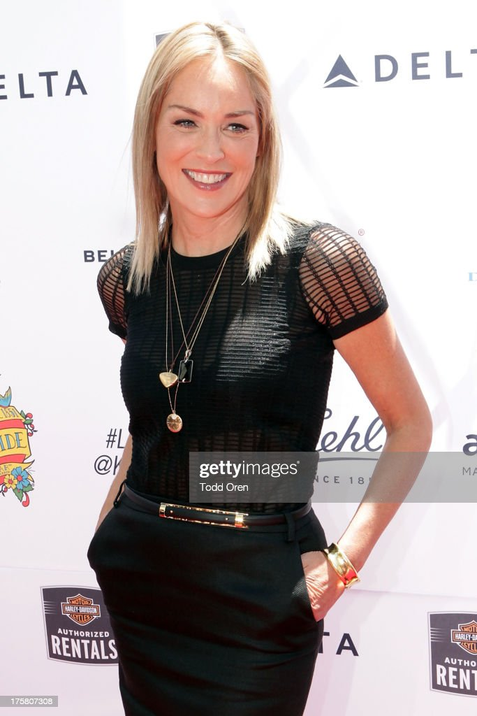 Actress <a gi-track='captionPersonalityLinkClicked' href=/galleries/search?phrase=Sharon+Stone&family=editorial&specificpeople=156409 ng-click='$event.stopPropagation()'>Sharon Stone</a> speaks at the Kiehl's Since 1851 Liferide for amfAR at The Grove on August 8, 2013 in Los Angeles, California.