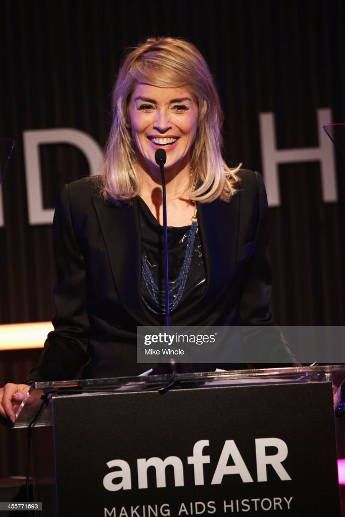 Actress <a gi-track='captionPersonalityLinkClicked' href=/galleries/search?phrase=Sharon+Stone&family=editorial&specificpeople=156409 ng-click='$event.stopPropagation()'>Sharon Stone</a> speaks onstage during the 2013 amfAR Inspiration Gala Los Angeles presented by MAC Viva Glam at Milk Studios on December 12, 2013 in Los Angeles, California.
