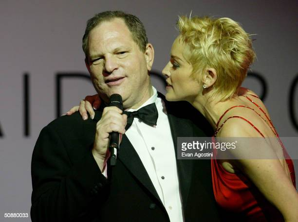 Actress Sharon Stone wearing Chopard jewelry and Harvey Weinstein speak on stage during the auction at 'Cinema Against AIDS 2004' the 11th annual...