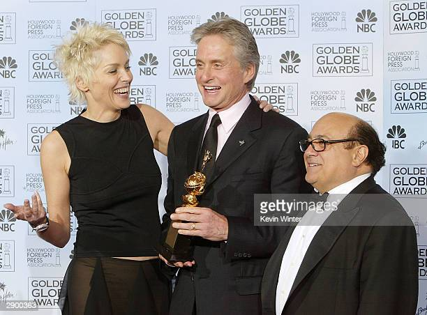 Actress Sharon Stone Winner of the Cecil B DeMille Award Actor Michael Douglas and Actor/Director Danny DeVito pose backstage at the 61st Annual...