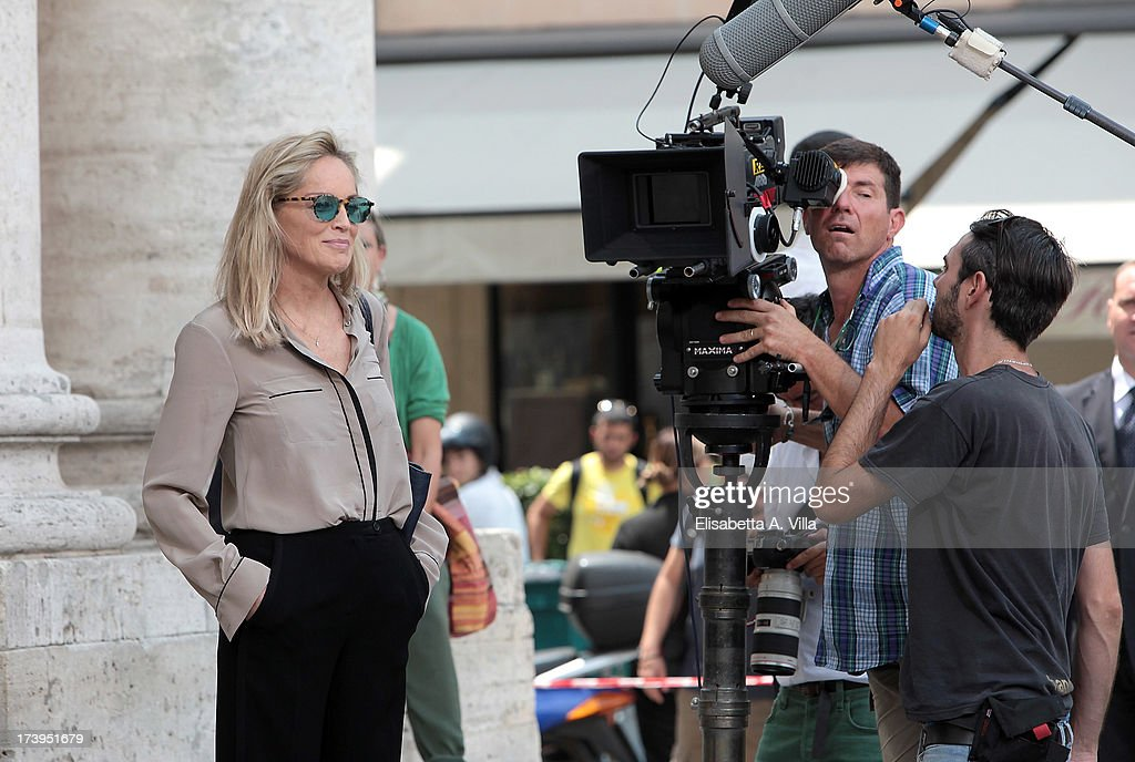 Actress <a gi-track='captionPersonalityLinkClicked' href=/galleries/search?phrase=Sharon+Stone&family=editorial&specificpeople=156409 ng-click='$event.stopPropagation()'>Sharon Stone</a> works on the set of the Italian movie 'Un Ragazzo D'Oro' (A golden boy) directed by Pupi Avati at Piazza Del Popolo on July 18, 2013 in Rome, Italy.