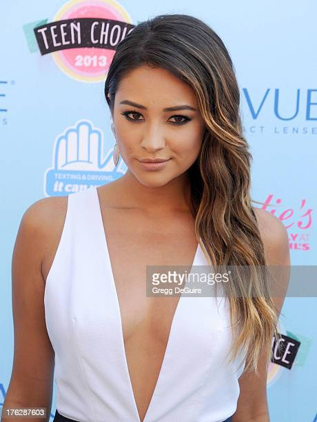Actress Shay Mitchell arrives at the 2013 Teen Choice Awards at Gibson Amphitheatre on August 11 2013 in Universal City California