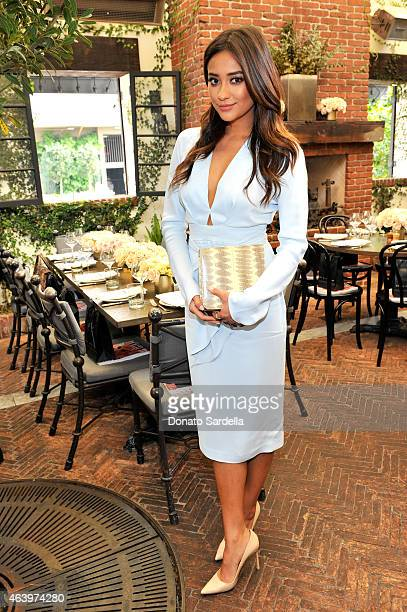 Actress Shay Mitchell attends NETAPORTERCOM celebrates Charlotte Tilbury at the AOC on February 20 2015 in Los Angeles California