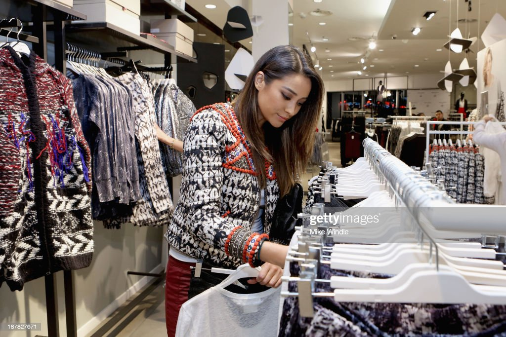 Actress <a gi-track='captionPersonalityLinkClicked' href=/galleries/search?phrase=Shay+Mitchell&family=editorial&specificpeople=6886213 ng-click='$event.stopPropagation()'>Shay Mitchell</a> attends the H&M Isabel Marant VIP Pre Shop Event at H&M on November 12, 2013 in West Hollywood, California.
