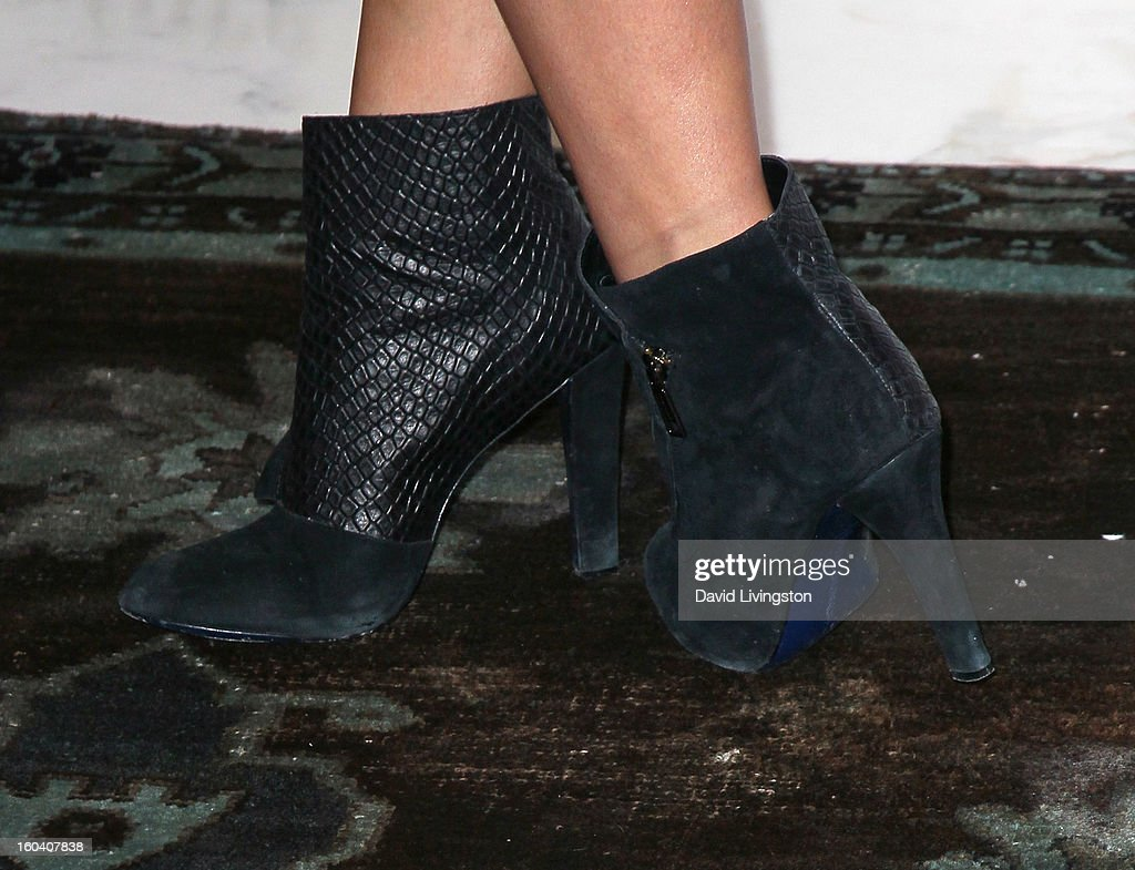 Actress <a gi-track='captionPersonalityLinkClicked' href=/galleries/search?phrase=Shay+Mitchell&family=editorial&specificpeople=6886213 ng-click='$event.stopPropagation()'>Shay Mitchell</a> (shoe detail) launches Juicy Couture's 'Couture La La' fragrance at Juicy Couture on January 30, 2013 in Beverly Hills, California.
