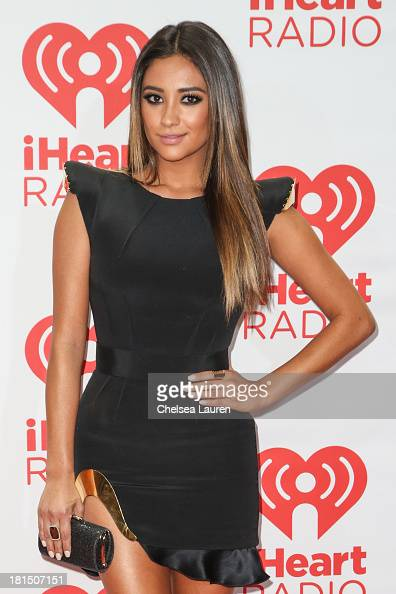 Actress Shay Mitchell poses in the iHeartRadio music festival photo room on September 21 2013 in Las Vegas Nevada