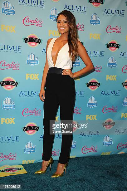 Actress Shay Mitchell poses in the press room at the 2013 Teen Choice Awards at Gibson Amphitheatre on August 11 2013 in Universal City California