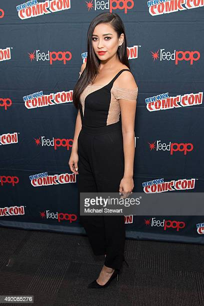 Actress Shay Mitchell poses in the press room for the 'Pretty Little Liars' panel during New York ComicCon Day 2 at The Jacob K Javits Convention...