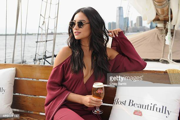 Actress Shay Mitchell toasted bon voyage to a summer of hosting beautifully with Stella Artois while sailing into the New York City sunset on...