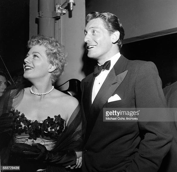 Actress Shelley Winters and actor Carlos Thompson attend the premiere of 'The High and the Mighty' in Los AngelesCA