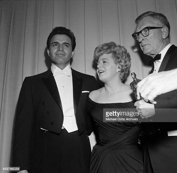 Actress Shelley Winters and actor Vince Edwards pose as they are presenters for Cinematography Award during the 34th Academy Awards in Los AngelesCA