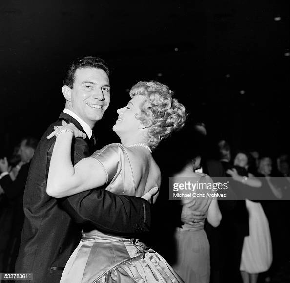Actress Shelley Winters and husband actor Anthony Franciosa dance during an event in Los AngelesCA